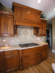 custom cabinets tile backsplash and gas cooktop adorn this beauty