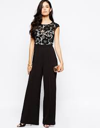 lace top jumpsuit lyst lipsy jumpsuit with lace top in black