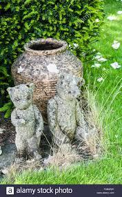 cast concrete teddy bears used as garden ornaments stock photo