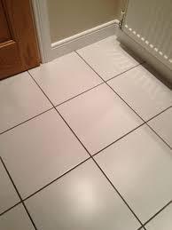 white floor tiles grey grout wood floors