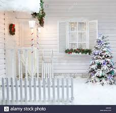 winter exterior of a country house with christmas decorations in