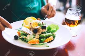 restaurant cuisine nicoise nicoise salad or tuna salad and glass of draft stock