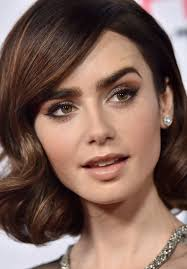 haircutsbfor women in their late 50 s lily collins she looks like she s from the late 50 s early 60 s