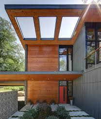entrance courtyard with cantilevered overhang wood roof with