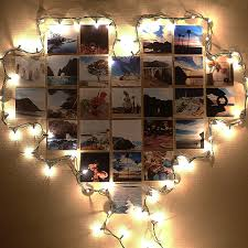 lights on wall with pictures super cozy ways to use string lights in your home decor