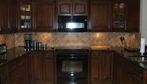 dark kitchen cabinets with light granite countertops outofhome