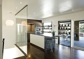 stylish glass kitchen divider between contemporary staircase and