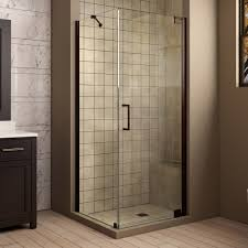 bathroom shower stalls with small glass windows and white ceramic