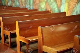 beautiful wooden church pews with a mural on the wall beside beautiful wooden church pews with a mural on the wall beside them stock photo 706031