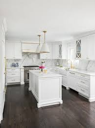 stained kitchen cabinets with hardwood floors white and gold kitchen with stained oak wood floors