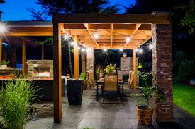 outdoor deck lighting with stacked stone pillar patio contemporary