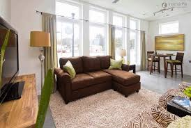 Living Room With Black Leather Furniture by Rooms With Brown Leather Furniture Black Wooden Table Lamp Beige