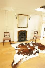 Cowhide Rug In Living Room Flooring Natural Cowhide Rug With Awesome Captivating Coloring