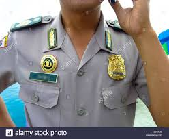 shirt with badges of police officer in indonesia stock photo