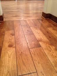 Wood Flooring In Kitchen by Hardwood Floors Borders Between Rooms Floor Runs The Other