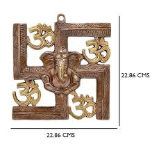 wall decor hangings buy wall decor hangings online at low jaipurcrafts wall hanging of lord ganesha on swastik with om showpiece 22 86 cm original and authentic