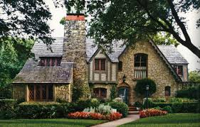 gorgeous stone and half timber tudor style home in dallas tx