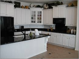 kitchen colors with white wood cabinets and black countertops