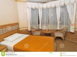 single bed in modern hotel room with furniture royalty free stock