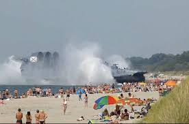 russian hovercraft lands on crowded beach