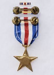 front view of the full size u s silver star medal a gold five