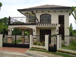 two storey building stylish facade of two storey house with iron fences part of