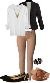 white blouse black jacket khaki pants black flat shoes