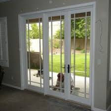 Thermastar By Pella Patio Doors Prairie Style Grilles With Double Hung Windows And A Hinged Patio