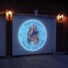 the personalized holiday greeting outdoor projector hammacher