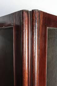 carved wood room divider wood and leather room divider for sale at 1stdibs