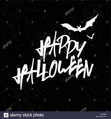 happy halloween lettering white letters on black textured stock