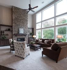 floor to ceiling stone surround gas fireplace with custom shelving