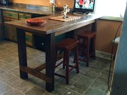 kitchen island bar table island comprised of stone wall and