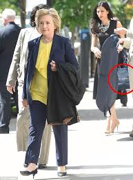 shopping designer clinton s aide carries designer shopping bags for