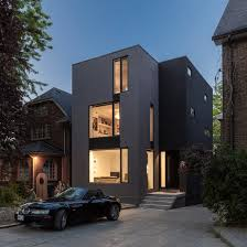 rzlbd divides black and grey toronto residence with central staircase