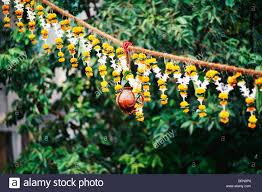 Krishnashtami Decoration Dahi Handi Curd Pot Decorated By Flowers Hanging On Janmashtami
