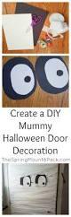 create a diy mummy halloween door decoration