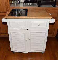 white painted kitchen island with marble cutting board insert in