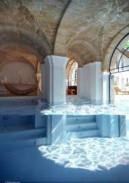 fancy house inside fancy insane swimming pool spanning inside to outside pools