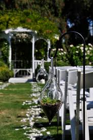 terrariums on hooks to define the ceremony aisle earthy elegant