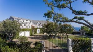 ivy wrapped pacific palisades mansion overlooks santa monica beach