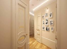 beautiful apartment hallway with white storage and blue wall paint