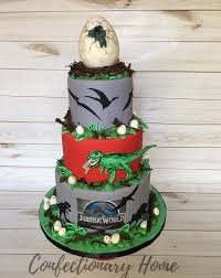 jurassic park cake topper dinosaur egg themed birthday cake the cake includes a hatching