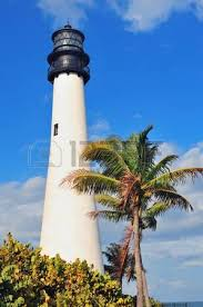 cape florida light lighthouse with atlantic and palm tree