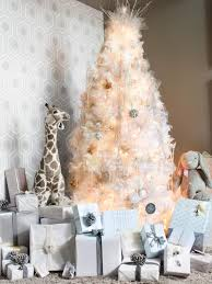 white tree with gold ornaments lights decoration