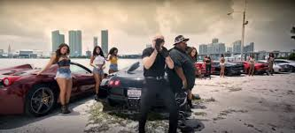 monster truck music video pitbull greenlight music video has bugatti veyron stretch limo and