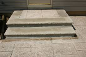 steps with limestone and stamped concrete landing
