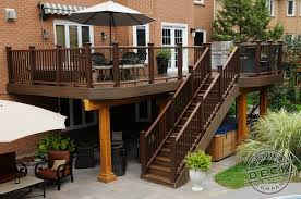 deck backyard ideas using trex decking railing and lighting the area under the deck