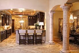 columns to divide rooms in open concept layout tuscan kitchen