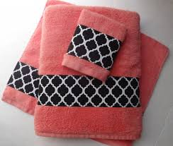 minimalist bathroom with coral bath towels design and pink black